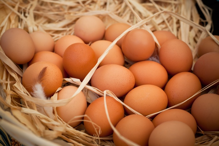 Basket of organic eggs in a rural farmers market